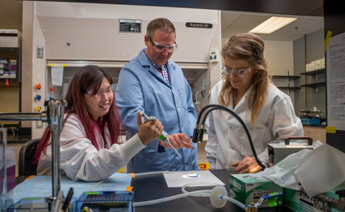 UD's John Slater (center) is part of a team that has developed an image-based, biomimetic patterning strategy that produces a more homogeneous cell population for high-throughput cellular assays. Photo by Kathy F. Atkinson