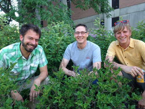 Scientists Stephen Good, David Noone and Gabriel Bowen pose at the University of Utah among plants, which their new study showed accounted for two-thirds of the water that reaches the atmosphere from rain and snowmelt that falls onto the continents but doesn't run off in rivers and streams. Good and Bowen are at the University of Utah, and Noone is at Oregon State University. Photo credit: Eileen Miller/University of Utah