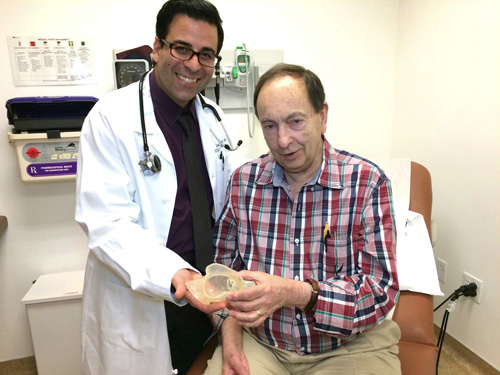 Dr. Jamil Aboulhosn and Richard Whitaker with a 3-D printed model of Whitaker's heart. Image credit: UCLA Health Sciences