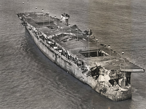 Aerial view of ex-USS Independence at anchor in San Francisco Bay, California, January 1951. There is visible damage from the atomic bomb tests at Bikini Atoll. Image credit: San Francisco Maritime National Historical Park