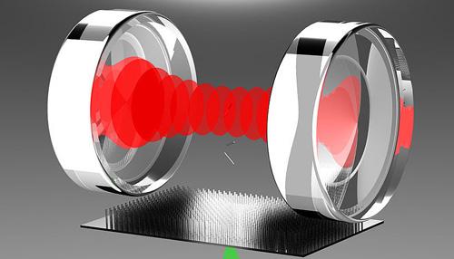 Nanorotoren werden durch eine Vakuumkammer katapultiert und durch Laserlicht zwischen zwei Spiegeln manipuliert (Image copyright: Gruppe Markus Arndt, Universität Wien; Bild: Stefan Kuhn).
