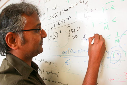Suresh Venkatasubramanian, an associate professor in the University of Utah's School of Computing, leads a team of researchers that have discovered a technique to determine if algorithms used for tasks such as hiring or administering housing loans could in fact discriminate unintentionally. The team also has discovered a way to fix such errors if they exist. Their findings were recently revealed at the 21st Association for Computing Machinery's SIGKDD Conference on Knowledge Discovery and Data Mining in Sydney, Australia. Photo credit: Vincent Horiuchi