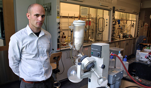 Seth Herzon in his lab, where he conducts extensive research on natural products synthesis and the development of new synthetic methods. (Photo by Michael S. Helfenbein, Yale University)