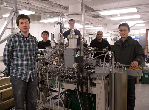 An international team led by Princeton University scientists has discovered Weyl fermions, elusive massless particles theorized 85 years ago that could give rise to faster and more efficient electronics because of their unusual ability to behave as matter and antimatter inside a crystal. The team included numerous researchers from Princeton's Department of Physics, including (from left to right) graduate students Ilya Belopolski and Daniel Sanchez; Guang Bian, a postdoctoral research associate; corresponding author M. Zahid Hasan, a Princeton professor of physics who led the research team; and associate research scholar Hao Zheng. (Photo by Danielle Alio, Office of Communications)