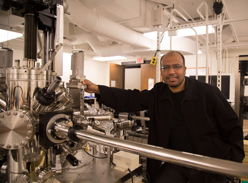 Hasan (pictured) and his research group researched and simulated dozens of crystal structures before finding the one suitable for holding Weyl fermions. Once fashioned, the crystals were loaded into this two-story device known as a scanning tunneling spectromicroscope to ensure that they matched theoretical specifications. Located in the Laboratory for Topological Quantum Matter and Spectroscopy in Princeton's Jadwin Hall, the spectromicroscope is cooled to near absolute zero and suspended from the ceiling to prevent even atom-sized vibrations. (Photo by Danielle Alio, Office of Communications)