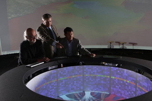 Rensselaer Polytechnic Institute (RPI) Curtis R. Priem Experimental Media and Performing Arts Center Director Johannes Goebel (left), Rensselaer Chief Information Officer and Vice President for Information Services and Technology John Kolb (middle), and IBM Research scientist and lab leader Hui Su (right) explore data with Campfire, as part of the Cognitive and Immersive Systems Laboratory. (Image Courtesy of Rensselaer)