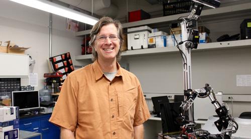 School of Information associate professor Clayton Morrison in his robotics lab (Photo credit: Emily Litvack/UANews)