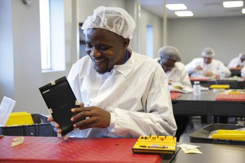 Operator Salah Macheremo, a native of Kenya, in the BAK USA clean room in Buffalo, New York. Photo credit: Microsoft