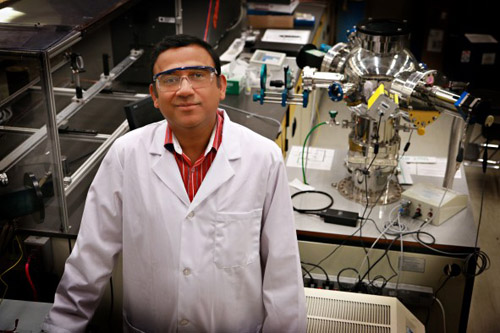 University of Utah materials science and engineering associate professor Ashutosh Tiwari stands in his lab where he and his team have discovered a new 2D semiconducting material made of tin and oxygen. This new material allows electrical charges to move through it much faster than common 3D material such as silicon. This breakthrough in semiconductor material could lead to much faster computers and mobile devices such as smartphones that also run on less power and with less heat. PHOTO CREDIT: Dan Hixson/University of Utah College of Engineering