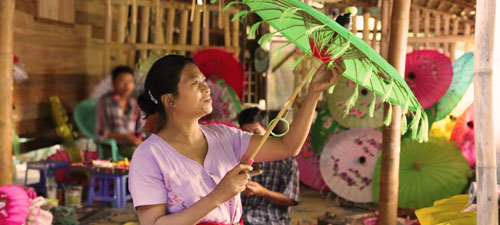 Top photo: Thin Thin Kine examines one of the umbrellas made in her factory in Myanmar. She is among those worldwide who have benefitted from the growth of cloud-based banking in emerging and developing markets, where traditional banking services are not available. Photo credit: Microsoft