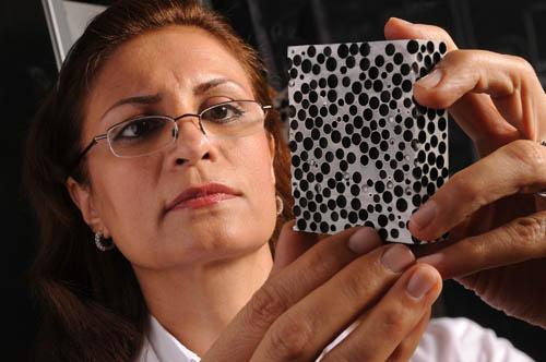Afsaneh Rabiei examines a sample of composite metal foam. Photo credit: North Carolina State University