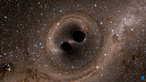 The collision of two black holes — an event detected for the first time ever by the Laser Interferometer Gravitational-Wave Observatory, or LIGO — is seen in this still from a computer simulation. LIGO detected gravitational waves, or ripples in space and time, generated as the black holes merged. The simulation shows what the merger would look like if we could somehow get a closer look. Time has been slowed by a factor of 100. The stars appear warped due to the strong gravity of the black holes. (Image by SXS)