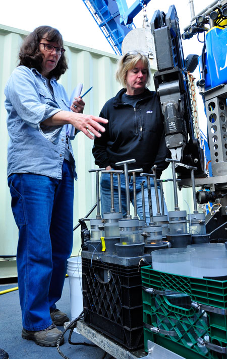 Joan Bernhard and Ginny Edgcomb discussing the samplers loaded onto ROV Jason during the 2011 cruise to the Mediterranean Deep Brines (Photo credit: Cherie Winner, Woods Hole Oceanographic Institution)