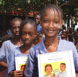 Schoolgirls in Guinea. Photo credit: Laura Lartigue (Source: Wikipedia)