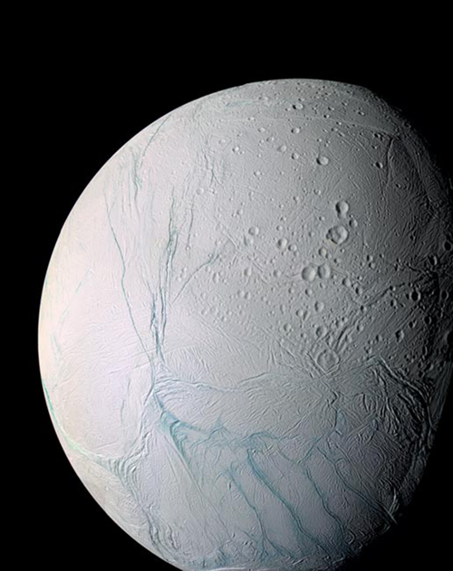 """Researchers from Princeton University and the University of Chicago show that the mysterious persistence of the massive fissures known as """"tiger stripes"""" on the surface of Saturn's sixth-largest moon, Enceladus, could be sustained by the sloshing of water in the vast ocean beneath the moon's thick ice shell. The findings could help provide a clear objective for future satellite missions to the Enceladus, which scientists suspect could host life. The enhanced-color image above shows the four tiger stripes (lower right) in the south polar region of Enceladus. (Photo by NASA/JPL/Space Science Institute)"""