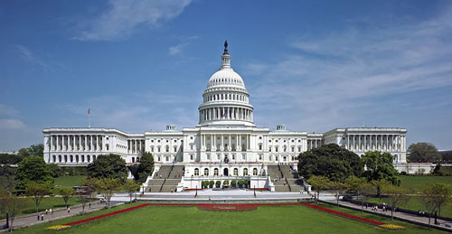 The western front of the United States Capitol. The Neoclassical style building is located in Washington, D.C., on top of Capitol Hill at the east end of the National Mall. The Capitol was designated a National Historic Landmark in 1960. Photo source: Commons.Wikimedia