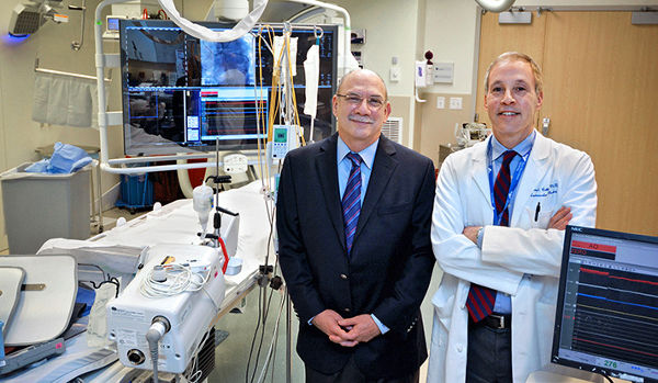 Dr. Michael Cleman and Dr. Henry Cabin, photographed in the Cardiac Cath Lab, launched a fellowship for interventional cardiologists at Yale in the mid-1980s. The program celebrates its 30th year in April. (Photo by Michael Marsland / Yale University)