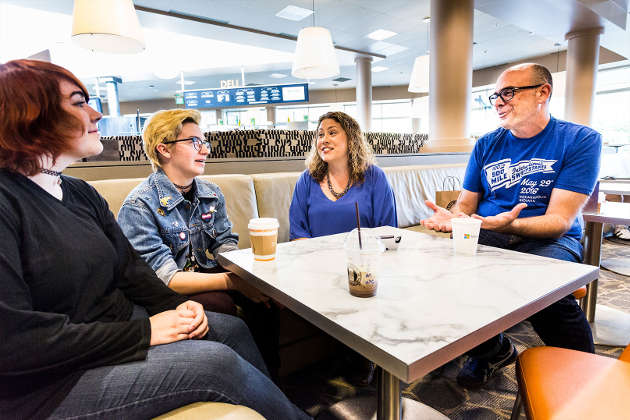 Katie Stone Perez and Chris Charla mentoring two young game developers. Photo by Brian Smale / © Microsoft