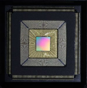 "Princeton University researchers have developed a new computer chip called ""Piton"" (above) — after the metal spikes driven by rock climbers into mountainsides to aid in their ascent — that was designed specifically for massive computing systems. The chip could substantially increase processing speed while slashing energy usage, and is scalable, meaning that thousands of chips containing millions of independent processors can be connected into a single system. It was presented Aug. 23 at Hot Chips, a symposium on high-performance chips held in Cupertino, California. (Photo by David Wentzlaff, Department of Electrical Engineering)"
