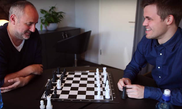 World chess champion Magnus Carlsen, right, with his manager Espen Agdestein. Image credit: Microsoft
