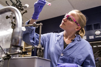 Gesine Veits examines a sample. Image credit: Joseph Xu, Michigan Engineering