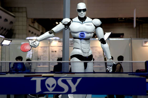 """TOPIO (""""TOSY Ping Pong Playing Robot"""") is a bipedal humanoid robot designed to play table tennis against a human being. TOPIO version 3.0 at Tokyo International Robot Exhibition, Nov 2009. Photo credit: Humanrobo (Source: Wikipedia)"""