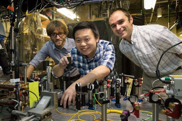 Wesley Campbell, assistant professor of physics and astronomy, Xueping Long and Andrew Jayich in Campbell's laboratory. Photo credit: Reed Hutchinson/UCLA