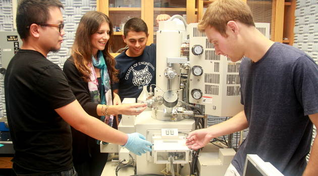 From left: Postdoctoral researcher Haokun Deng, associate professor of civil engineering and engineering mechanics Katerina Aifantis, and mechanical engineering undergraduates Fabian Medina and Andrew Barr prepare materials for electron microscopy in the lab. Image credit: University of Arizona