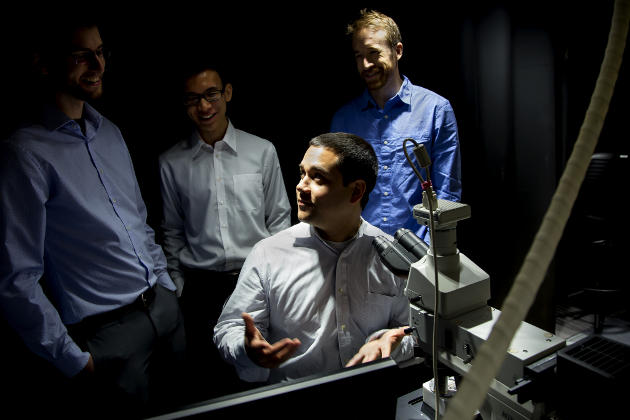 Neil Dasgupta, Assistant Professor of Mechanical Engineering, discusses findings of a visualization cell of a battery with Kevin Wood, ME Research Fellow; Eric Kayak, ME PhD Student; and Kuan-Hung Chen, Materials Science & Engineering MSE Student. The visualization cell acts as a window for batteries, allowing for researchers to gain insights into various components of batteries. Image credit: Joseph Xu/Michigan Engineering
