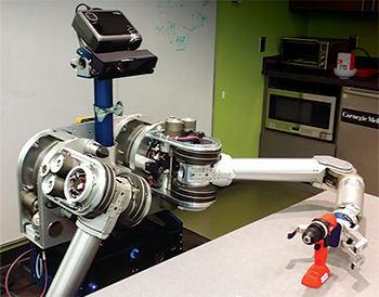 A robot grasps a power drill.  Image credit: Yale University