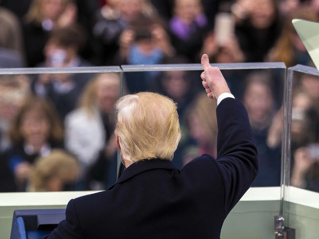 President Donald J. Trump gives a thumbs-up to the spectators during his presidential inaugural address during the 58th Presidential Inauguration at the U.S. Capitol Building, Washington, D.C., Jan. 20, 2017. Photo by U.S. Army Staff Sgt. Michael S. O'Neal (Source: Defense Media Activity)