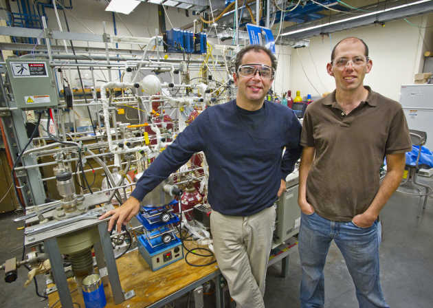 Dean Toste, left, of Berkeley Lab and UC Berkeley, and Elad Gross, right, of the Hebrew University of Jerusalem, led a study of site-specific chemical reactivity on tiny platinum and goldparticles at Berkeley Lab's Advanced Light Source. (Image credit: Roy Kaltschmidt/Berkeley Lab)