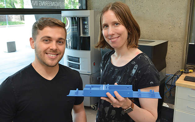 Max Emerson, a fellow at the Center for Engineering Innovation and Design, and Christine Lattin, a fellow in radiology and biomedical imaging, with a 3D-printed device that holds a house sparrow during a medical imaging process. Image credit: Yale University
