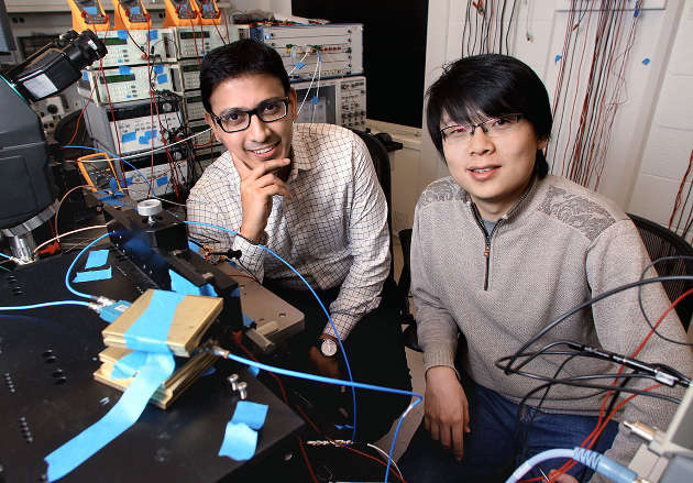 In two recently published articles, researchers Kaushik Sengupta (left), an assistant professor of electrical engineering, and Xue Wu (right), a Princeton graduate student in electrical engineering, describe one microchip that can generate terahertz waves, and a second chip that can capture and read intricate details of these waves. Terahertz waves sit between the microwave and infrared light wavebands on the electromagnetic spectrum and have unique characteristics, such as the ability to pass through most non-conducting material such as clothing or boxes without damaging human tissue or DNA. (Photo by Frank Wojciechowski for the Office of Engineering Communications)