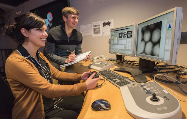 Mary Scott (left) and Peter Ercius at the controls of the TEAM microscope at the Molecular Foundry's National Center for Electron Microscopy. (Image credit: Marilyn Chung)