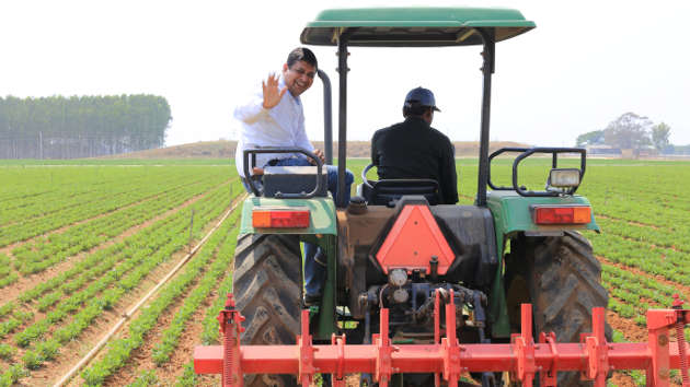 Prashant Gupta rides on a tractor with a farmer in the state of Andhra Pradesh in India. Image credit: Microsoft