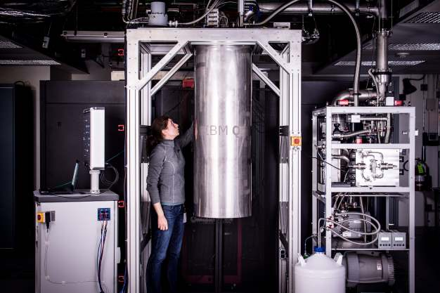 IBM Research Staff Member Katie Pooley, an Applied Physics PhD from Harvard who joined IBM in 2015, at the Thomas J Watson Research Center, is a process integrator on the IBM Q team. In the photo, Pooley is examining a cryostat with the new prototype of a commercial quantum processor inside. (Image credit: Andy Aaron, IBM)