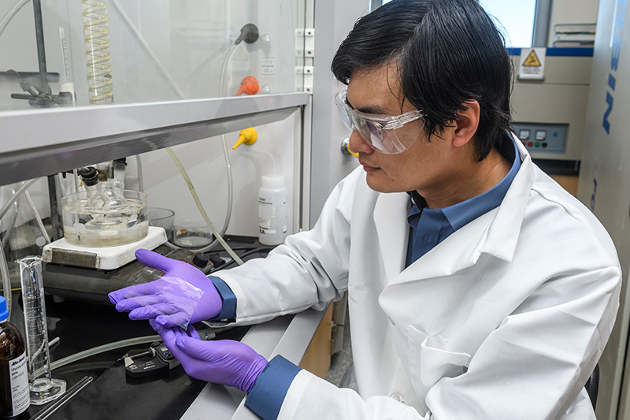Liang Wang, associate scientist in UD's Department of Mechanical Engineering, in the laboratory. Photo by Kathy F. Atkinson