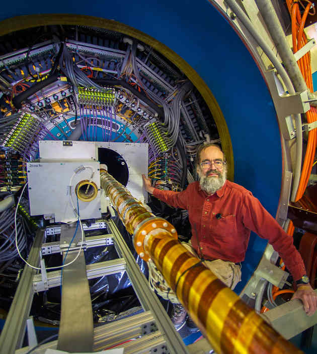 Brookhaven Lab physicist Flemming Videbaek during installation of the Heavy Flavor Tracker at the STAR detector at RHIC, a world-class particle collider at Brookhaven National Laboratory. (Image credit: Brookhaven Lab)