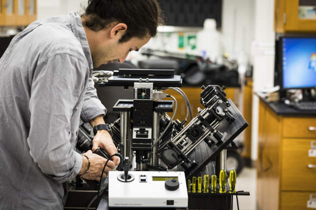 Mechanical engineering postdoctoral fellow Adam Glaser assembles the next generation of the light-sheet microscope, which will provide greater resolving power and imaging depth than the first system. Image credit: Mark Stone/University of Washington