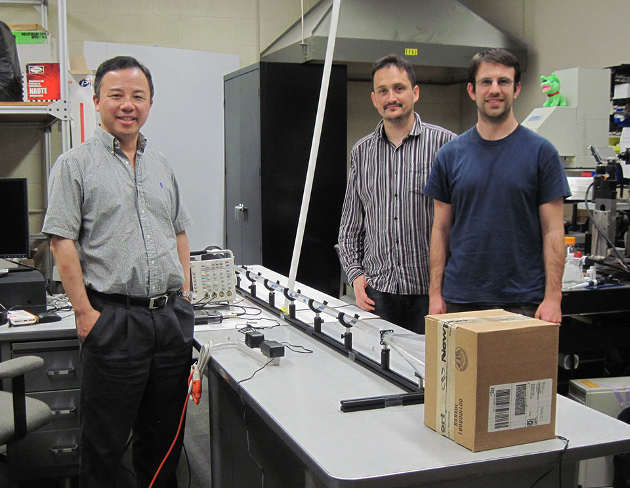 Xiang Zhang, Nicolas Bachelard, and Chad Ropp (l-r) stand next to their experimental setup for testing particle response to acoustic waves. (Image credit: Berkeley Lab)
