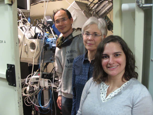 ALS scientists Nobumichi Tamura, left, and Camelia Stan, right, work with Marie Jackson, center, a University of Utah professor, to study Roman concrete samples at the microscale using X-ray Beamline 12.3.2. (Image credit: Berkeley Lab)
