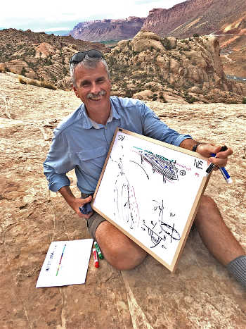 Paleofluids collaborator and structural geologist Bob Krantz reviews Paradox Basin tectonic history overlooking the Moab Fault. (Photo credit: Peter Reiners)