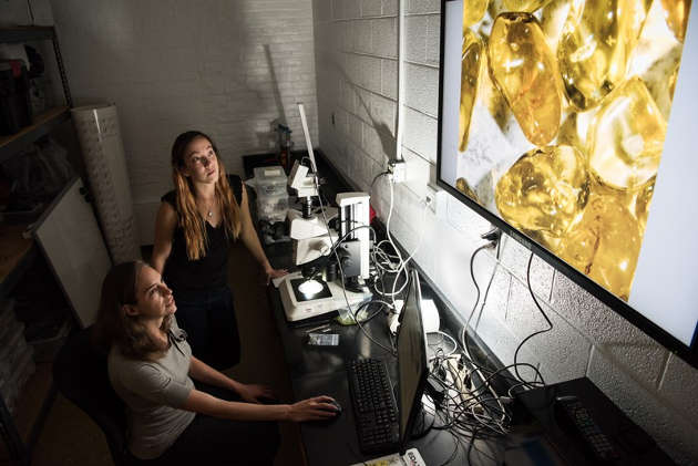 New research by UD petrologist Jessica Warren (seated), Stanford's Kathryn Kumamoto (standing) and colleagues demonstrates that the strength of olivine is size-sensitive. Photo by Evan Krape