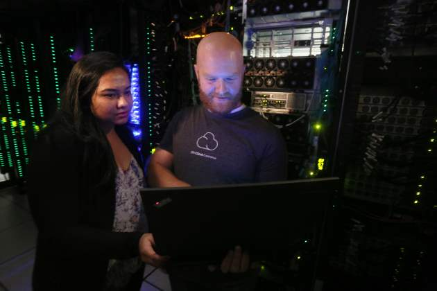 Software engineers Shibani Raikar and Brad Hoover test IBM Cloud Private automation software in the IBM Cloud Innovation Lab in Austin, Texas. Today, IBM announced IBM Cloud Private, a new software platform using open source container technology to help unlock billions of dollars in core data and applications built on enterprise software like WebSphere and Db2 and extend cloud-native tools across public and private clouds. (Image credit: Jack Plunkett/Feature Photo Service for IBM)