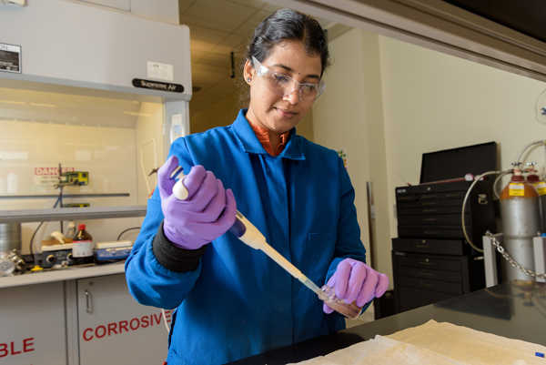 Sunitha Sadula, a postdoctoral researcher at UD's Catalysis Center for Energy Innovation, a DOE Energy Frontier Research Center, works in the lab to extract sugars from wood chips, corn cobs and other forest and farm waste. Photo by Evan Krape