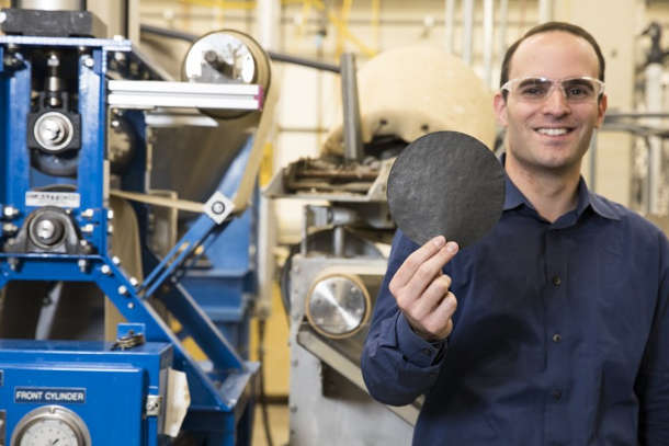 """Anthony Dichiara, a University of Washington professor in the School of Environmental and Forest Sciences, holds a piece of """"smart"""" paper created in his lab. Image credit: Mark Stone/University of Washington"""