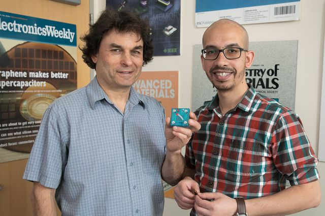 Richard Kaner and Maher El-Kady with a replica of a new device that can use solar power to inexpensively and efficiently create and store energy. Photo credit: Reed Hutchinson/UCLA