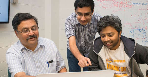 Left to right, Professor Vijay Shanker reviews data with graduate students Samir Gupta and Ashique Mahmood. Photo by Wenbo Fan