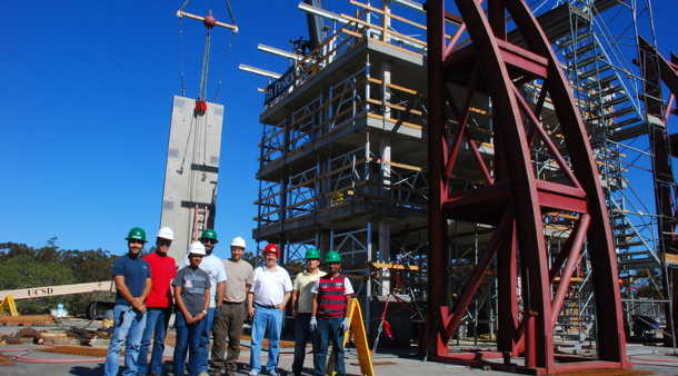 Robert Fleischman and members of his research team stand dwarfed by a test structure built on the shake table at UC San Diego's Englekirk Structural Engineering Center. Image credit: University of Arizona
